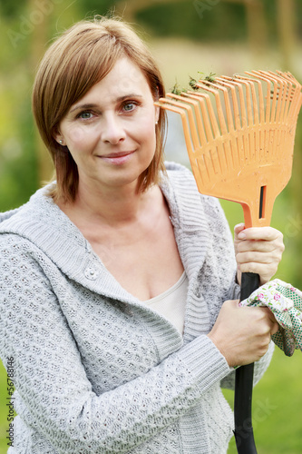 Gardening - mature woman working in the garden