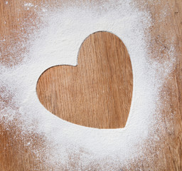 The heart of the flour on the table from the old boards. dramati
