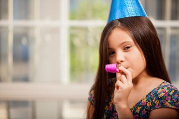 Cute little girl in a party hat
