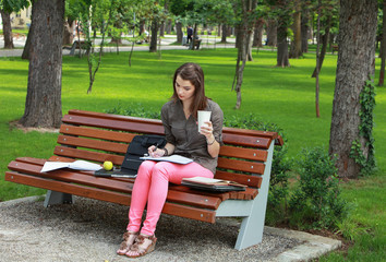 Young Woman Studying in a Park