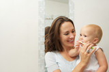 Fototapety Mother teaching cute baby how to brush teeth with toothbrush