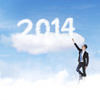 Businessman climbing upward to 2014