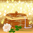 background casket with pearls and a rose