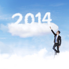 Businessman climbing upward to 2014