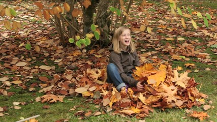 Girl raking fall leaves
