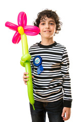 Holding a flower balloon on his birthday