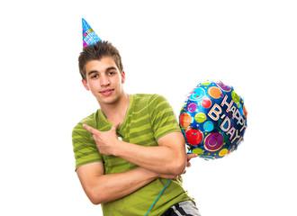 Teenager holding a happy birthday balloon