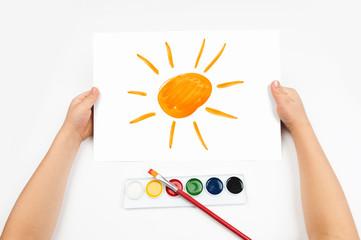 Child draws the sun watercolors