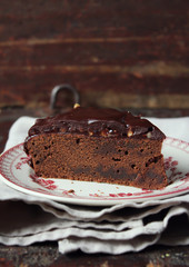 Piece of dark chocolate cake with chocolate frosting