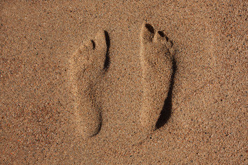 Traces of human feet in the sand