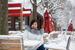 Girl in an outdoor cafe on a winter day