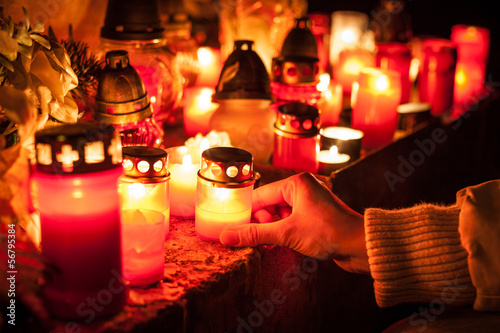 Candles Burning At a Cemetery. Shallow depth of field.