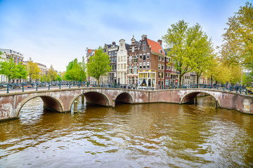 Amsterdam. Bridge and water canal. Holland or Netherlands.