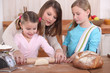 Mother and daughters baking