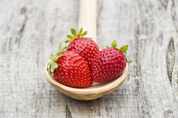 Strawberries in a wooden spoon