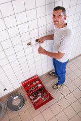 Electrician repairing electrical outlet in bathroom