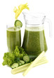 Glass and jug of green vegetable juice and vegetables isolated