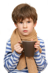 The sick child holds a cup
