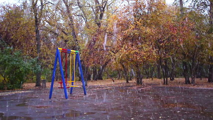 Swings in the park. It's snowing, Ekaterinburg, Russia