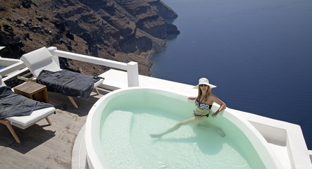 woman in private pool over the cliff