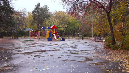 Children's playground in the fall. It's snowing, Ekaterinburg