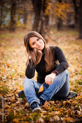 beautiful thoughtful girl  in autumn park
