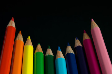 Color pencils isolated on black