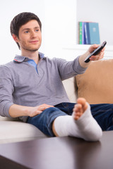 Man watching TV in bandage