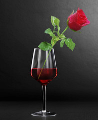 Glass of red wine and roses