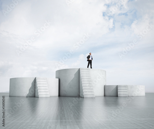 man standing on highest podium