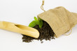 bamboo scoop and chinese tea leaves in sackcloth