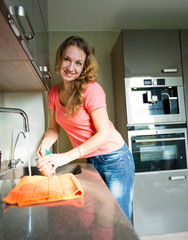 Happy Young Woman Washing cup. Kitchen. Dishwashing.