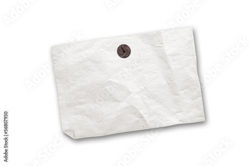 Empty old paper ad hanging on push pin isolated on white