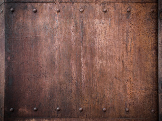 old metal background with rivets