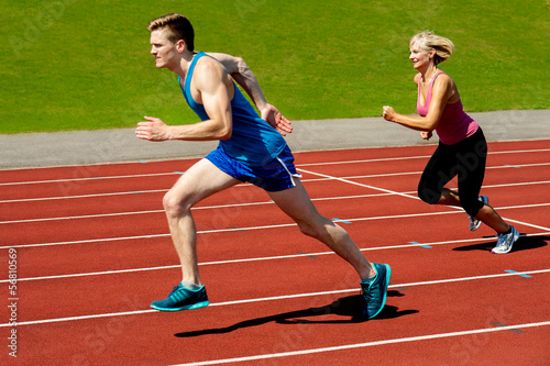 Athletes running on race track