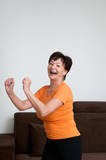 Senior fitness woman exercising at home