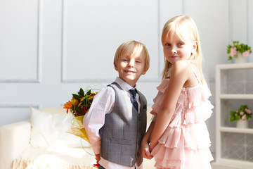 Boy is presented flowers to girl