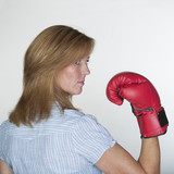 Woman wearing a red boxing glove