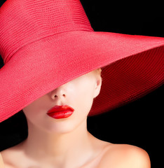 mysterious beauty in red hat with red lips