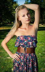 Fashion Blond Female Model Posing in Park
