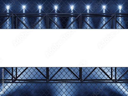 Empty display , chainlink fence and spotlights