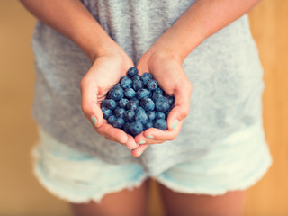 Woman with Fresh Blueberries