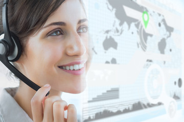 Cheerful call center employee using futuristic interface hologra