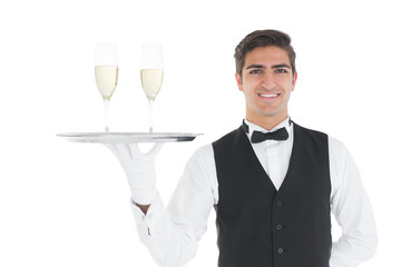 Smiling attractive holding a tray with champagne glasses on it