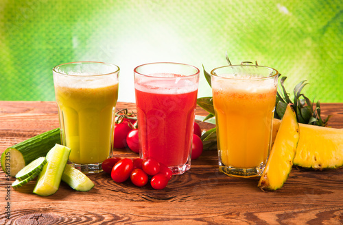 Fruits, vegetables and juice on wood