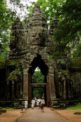 Buddhist nuns walk to the Angkor Archaeological