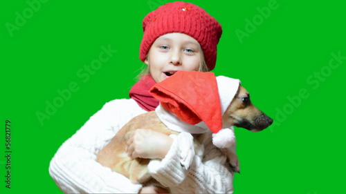girl and dog in santa hat
