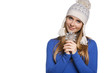 Winter woman wearing warm clothing holding a snowflake