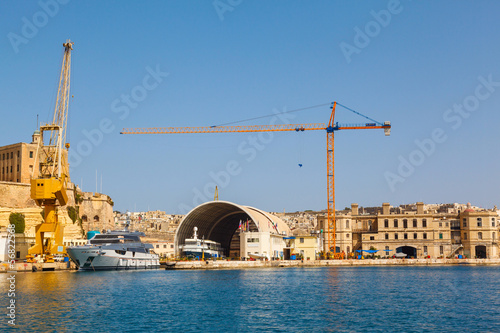 Port cargo crane in Shipyards harbor of Malta