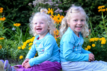 two blond laughing girls